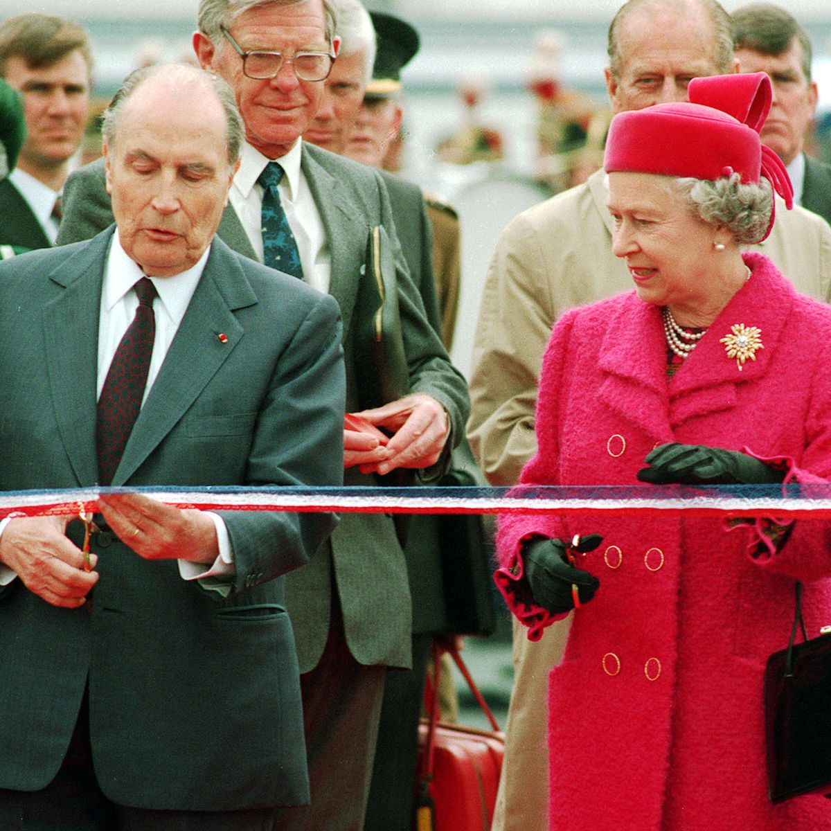 French President Francois Mitterand and the Queen preparing to cut the ribbon at the new terminal for the Channel Tunnel at Coquelles, France, in 1994