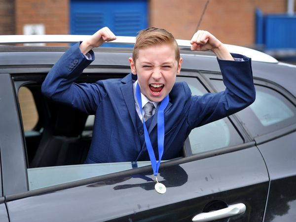Year six pupil Fraser Brewer enjoys the drive-through prom held at his school, Priorslee Primary Academy, to mark the end of term