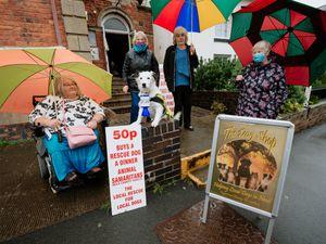 Elizabeth Black, Janet Gamble, Gloucester the Dog, Rose Davies and Margaret Watkin outside the The Dog Shop in Bishop's Castle