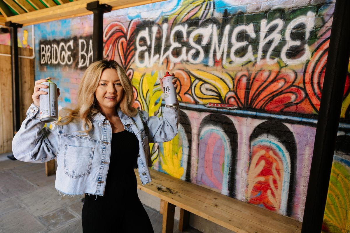 Apprentice tattooist Lucy Rose Williams from Ellesmere has painted a mural on the new outside bar area of the Ellesmere Hotel