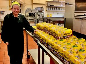 Michelle Clarkson from Grove School's catering team with the loaves of bread for the school's breakfast initiative