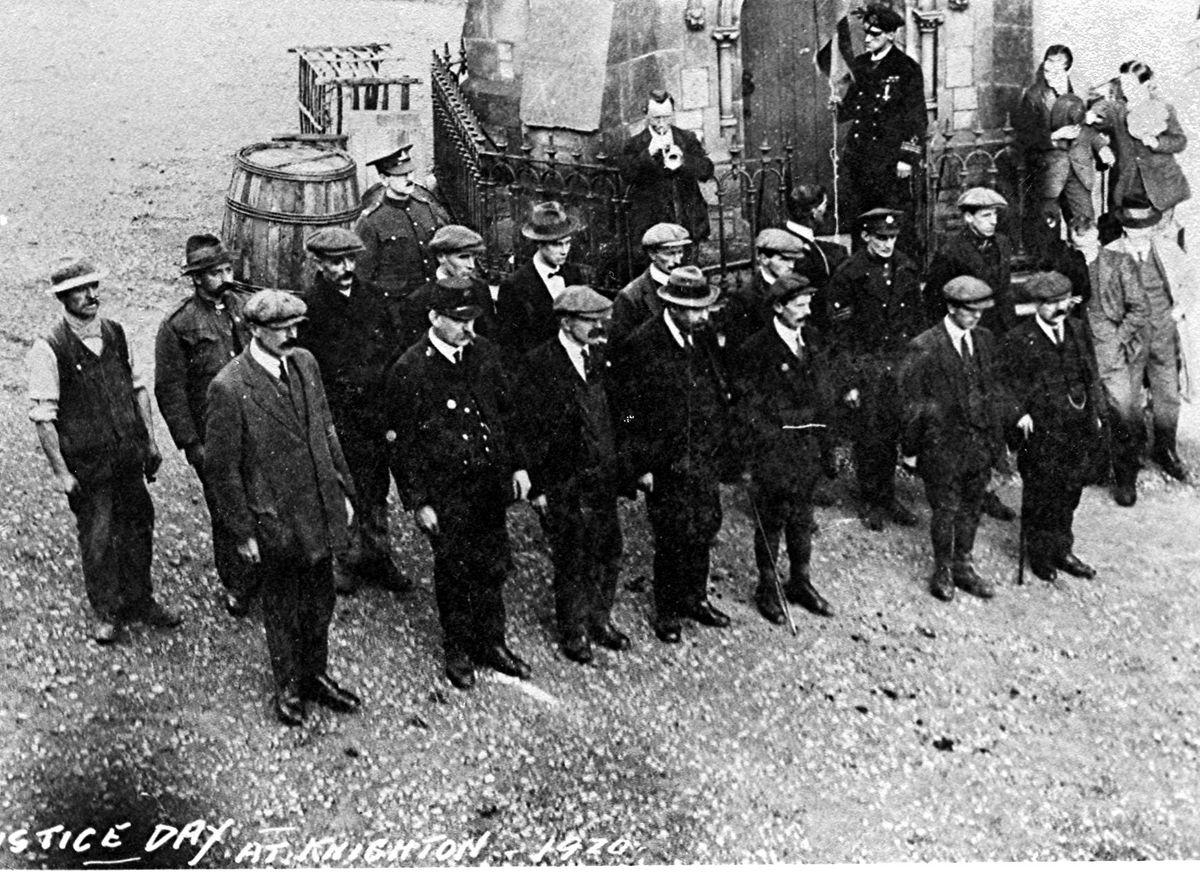 The Great War will still have been very fresh in the memories of this group commemorating Armistice Day in Knighton in 1920. They are standing in front of the town's clock tower. Look closely and you can see a bugler playing, so no doubt they are standing at attention for the Last Post.
