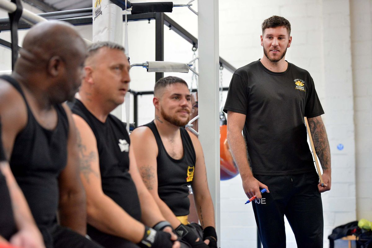 Head coach Joe Lockley with members of the Bright Star Boxing Academy in Shifnal.