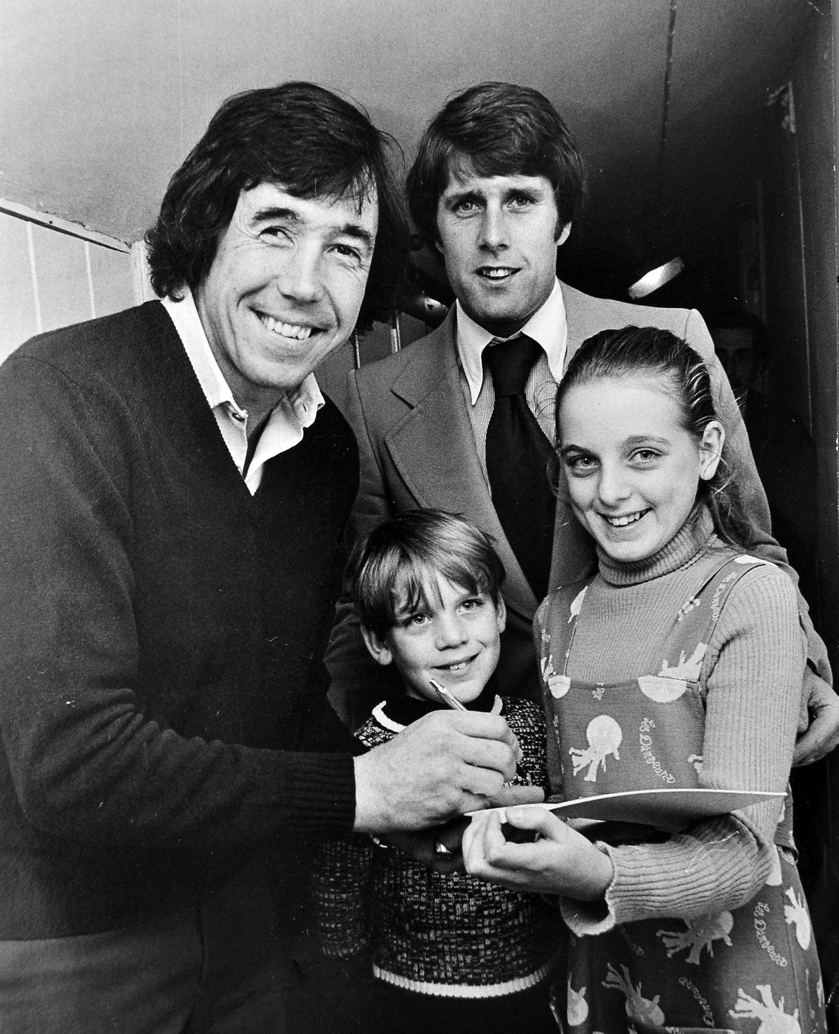 Youngsters Carol and Anthony Bates pictured with Banks and Geoff Hurst in Telford in 1976
