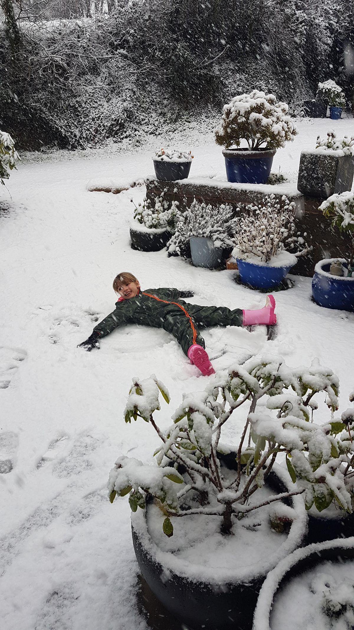 Eleanor, 5, making snow angels in Westhope. Pic: Amy Jane Owen.