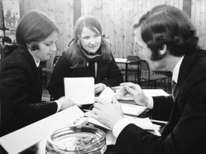 nostalgia pic. Wellington. Careers convention at Wellington in March 1971. This is a print in the Shropshire Star picture archive and the handwritten caption on the back reads: 'Wrekin Youth Employment Committee has arranged a careers convention for schools in the area at Wrekin Youth Centre. From left are Wellington schoolgirls Marilyn Gough and Elaine James talking to Mr H. Clayton-Jones of Walker Technical College.' The date given next to the caption is 16.3.71, i.e. March 16, 1971, which is likely to be the publication date. The print has the Shropshire Star copyright stamp and the photographer was Dave Bagnall. Careers advice. Note the ashtray and packet of Embassy cigarettes and matches on the table. Library code: Wellington nostalgia 2020..