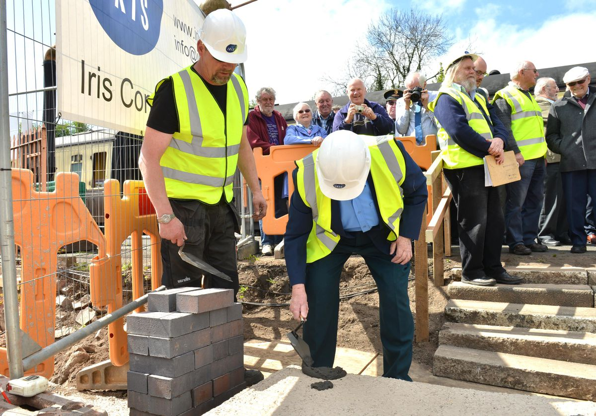 Former railway worker Barry Cook watched by Site Manager Darren Cadet lays the first brick for the new building at Bridgnorth Severn Valley Railway Station,