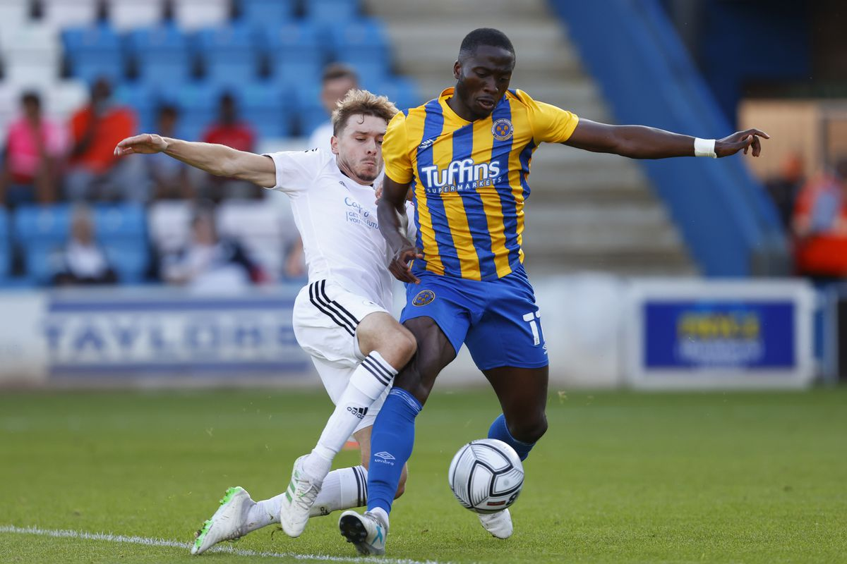Henry Cowans of AFC Telford United and Dan Udoh of Shrewsbury Town. (AMA)
