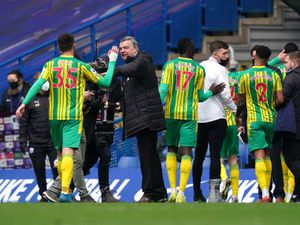 """West Bromwich Albion manager Sam Allardyce celebrates with Okay Yokuslu after during the Premier League match at Stamford Bridge, London. Issue date: Saturday April 3, 2021. PA Photo. See PA story SOCCER Chelsea. Photo credit should read: John Walton/PA Wire...RESTRICTIONS: EDITORIAL USE ONLY No use with unauthorised audio, video, data, fixture lists, club/league logos or """"live"""" services. Online in-match use limited to 120 images, no video emulation. No use in betting, games or single club/league/player publications.."""