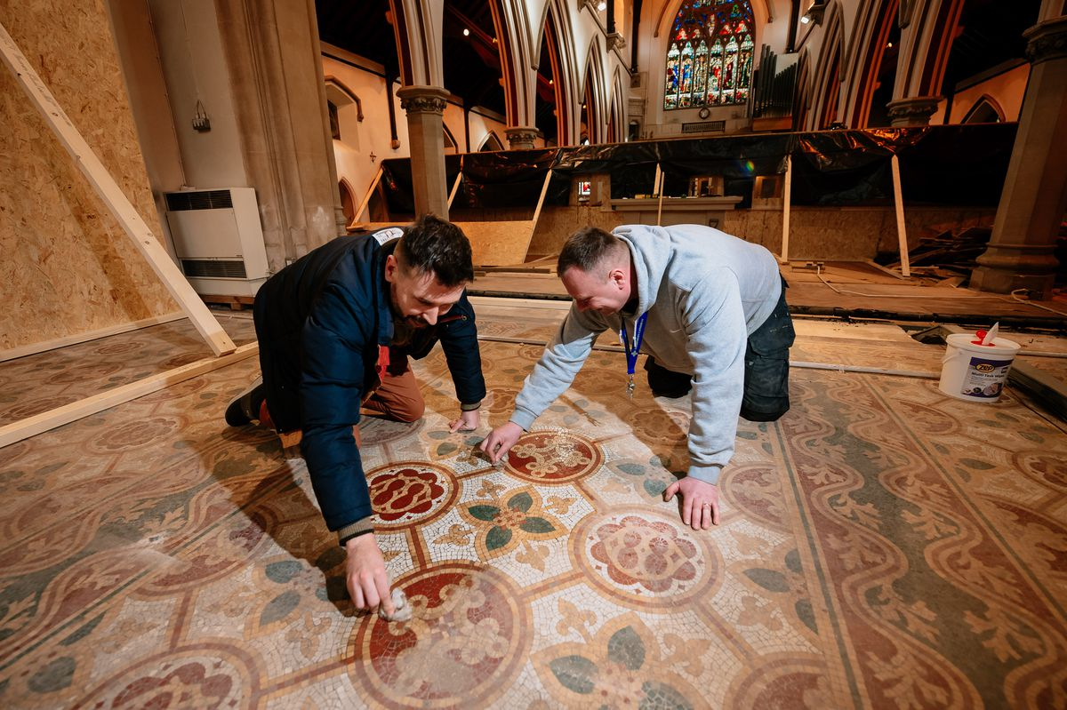 Richard Keddie and a colleague help to clean up the tiles to reveal stunning details