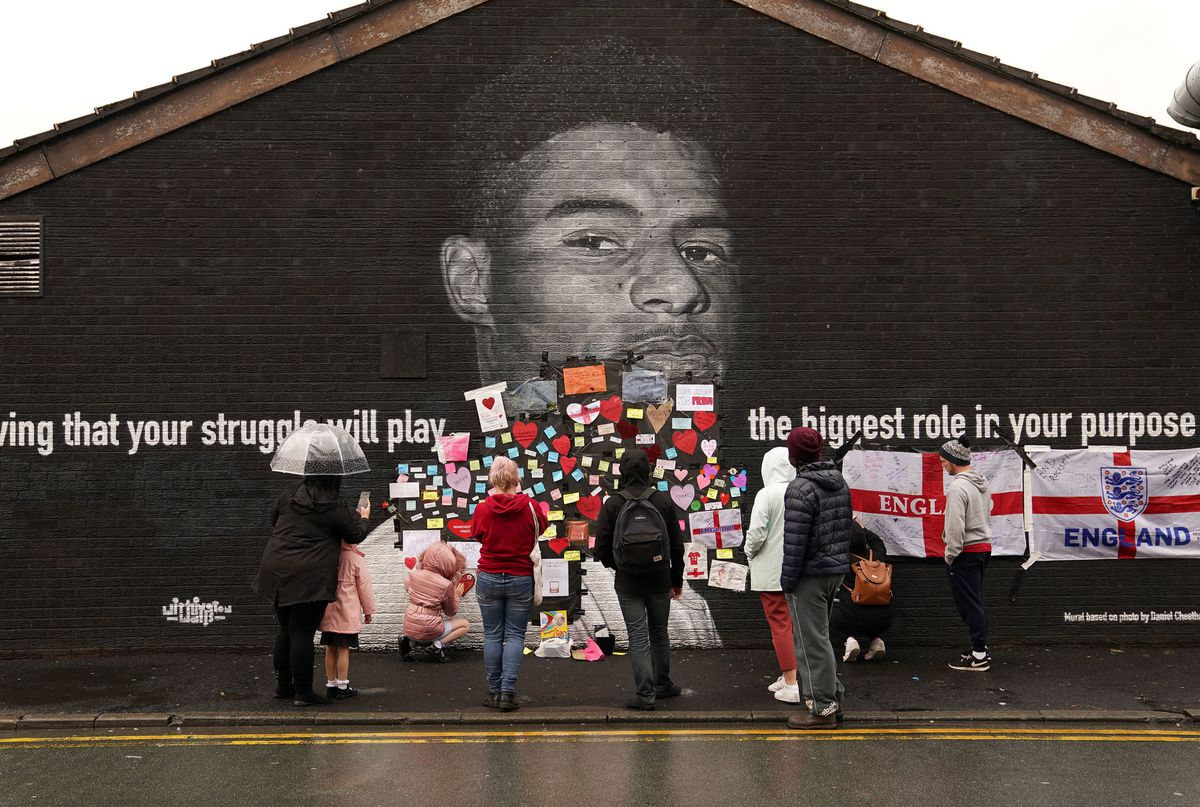Fans have been posting messages of support on a mural of Marcus Rashford after it was defaced. Photo: Martin Rickett/PA Wire
