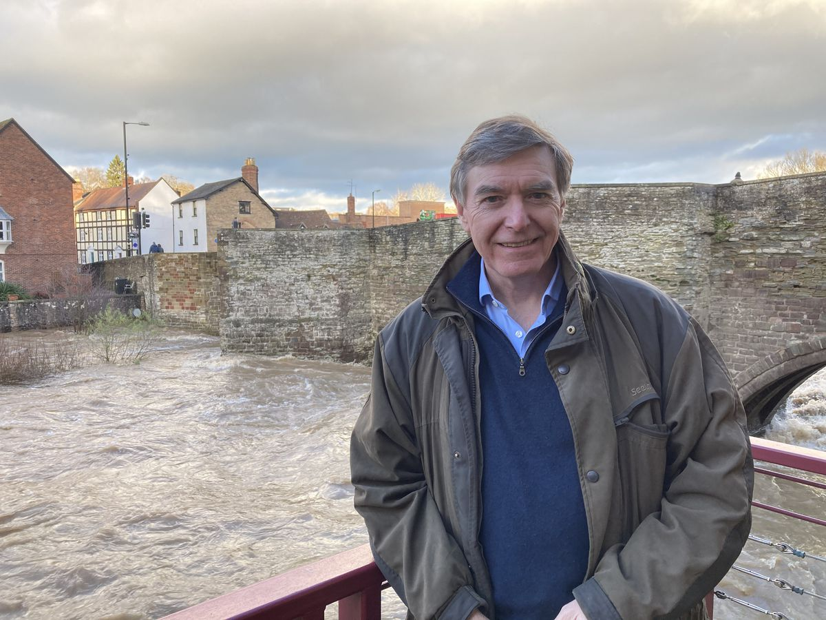 MP Philip Dunne besides the River Teme at Ludford Bridge, Ludlow