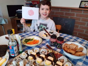 Freddie, pictured with his Japan flag, enjoys making and eating sushi