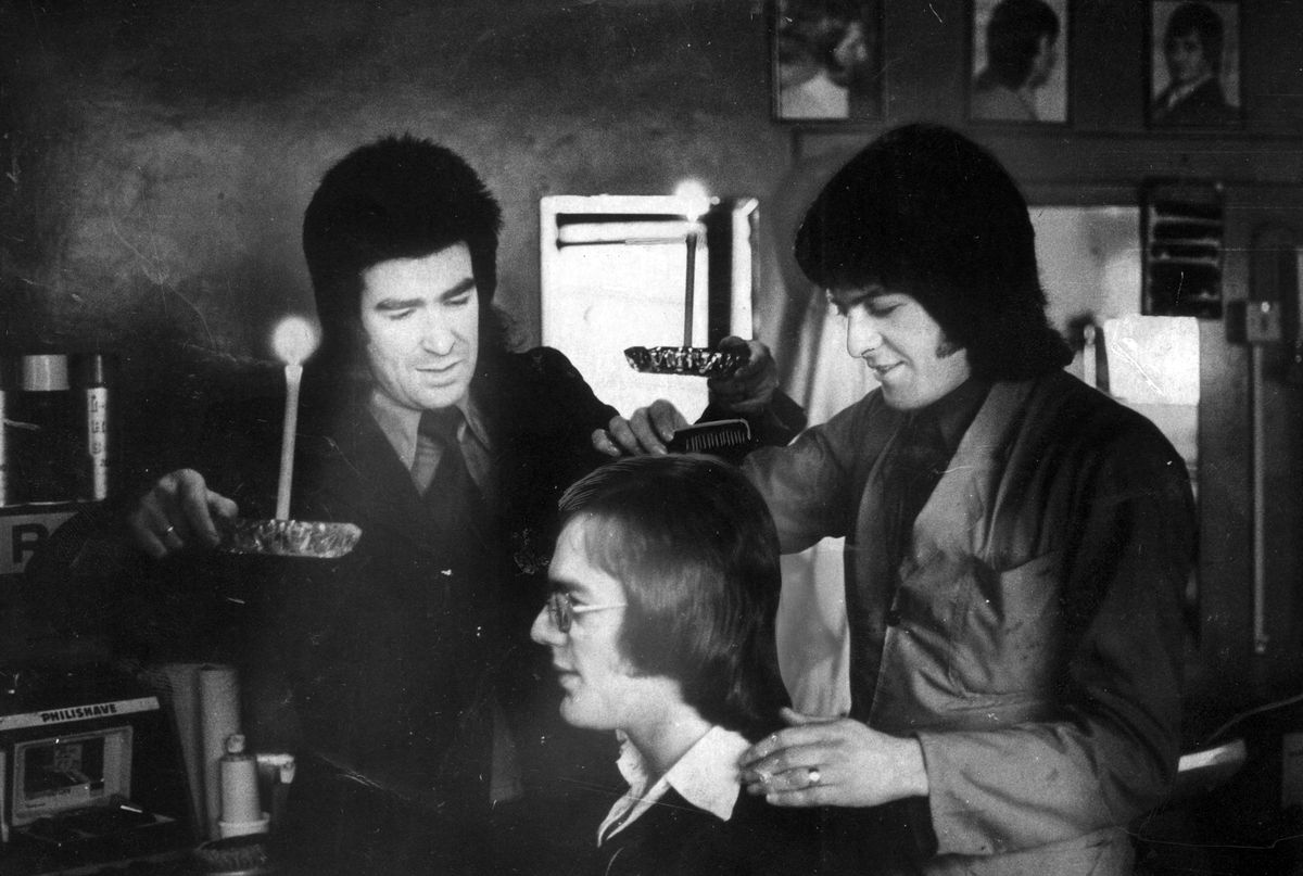 Dudley hairdressers Colin Dunn and Pete Woodall were getting around the restrictions imposed by the 1974 three-day week by trimming people's hair by candlelight on non-electricity days.