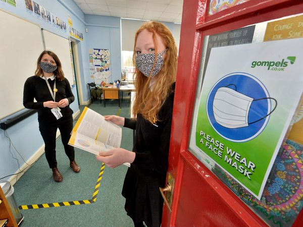 Teacher Penny Brown, in a specially-marked space, and pupil Paige Branford, 15, at Sir John Talbot's School, Whitchurch