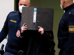 Defendant Jennifer W arrives in a courtroom for her trial in Munich, Germany