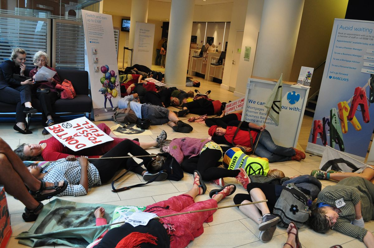Members lay on the floor while customers and staff looked on