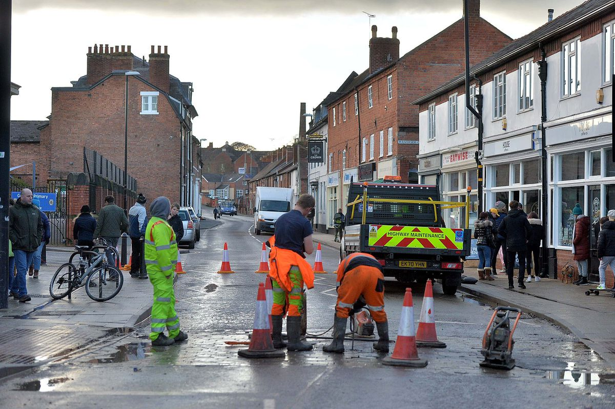 Council workers clean up in Coleham after the floods