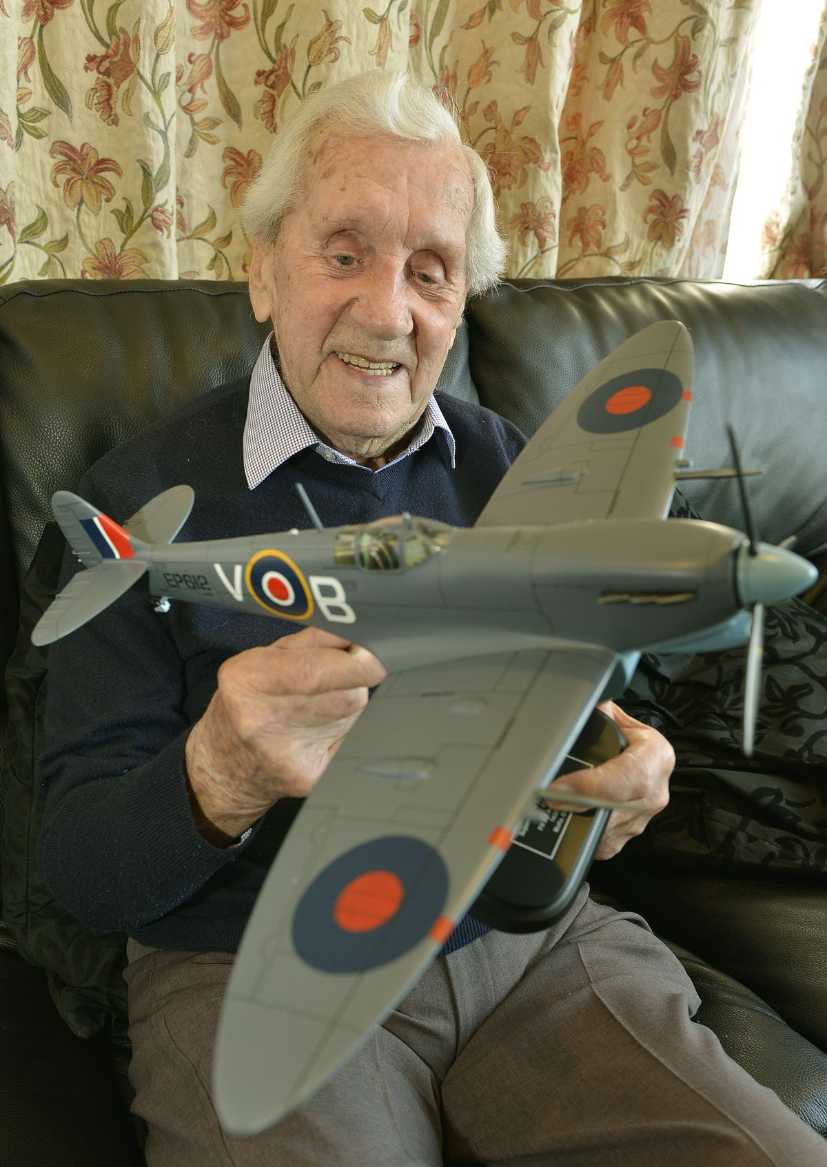Allan Scott with a large model Spitfire