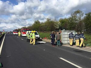 Pictures and video: Traffic chaos as busy A5 at Shrewsbury closed after cattle trailer overturns