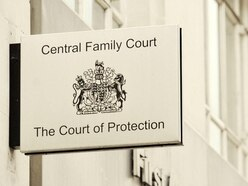 Judge tells divorcee not to take ex's half-clothed woman portrait when leaving
