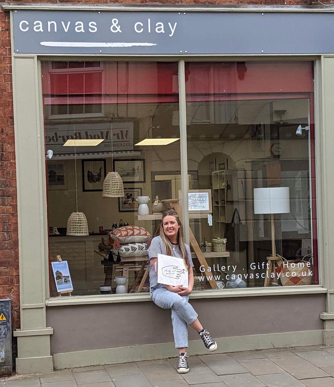 Sam outside her shop.