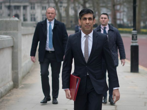 Chancellor Rishi Sunak walks from the Treasury to No 11 Downing Street