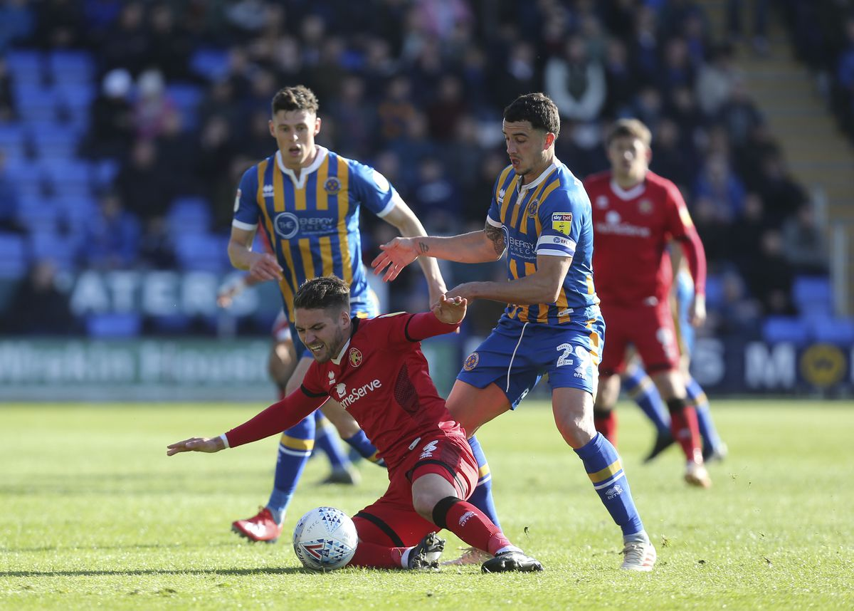 Luke Leahy of Walsall and Oliver Norburn of Shrewsbury Town (AMA)