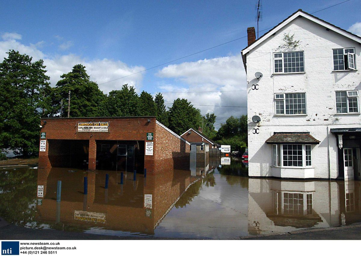 Flooded houses in  Ludlow, Shropshire, after a bridge collapsed causing severe flooding. The road collapsed last night after heavy rainfall and much of the town has been flooded.