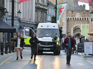 Police officers in Cardiff city centre before Wales entered a two-week 'firebreak' lockdown