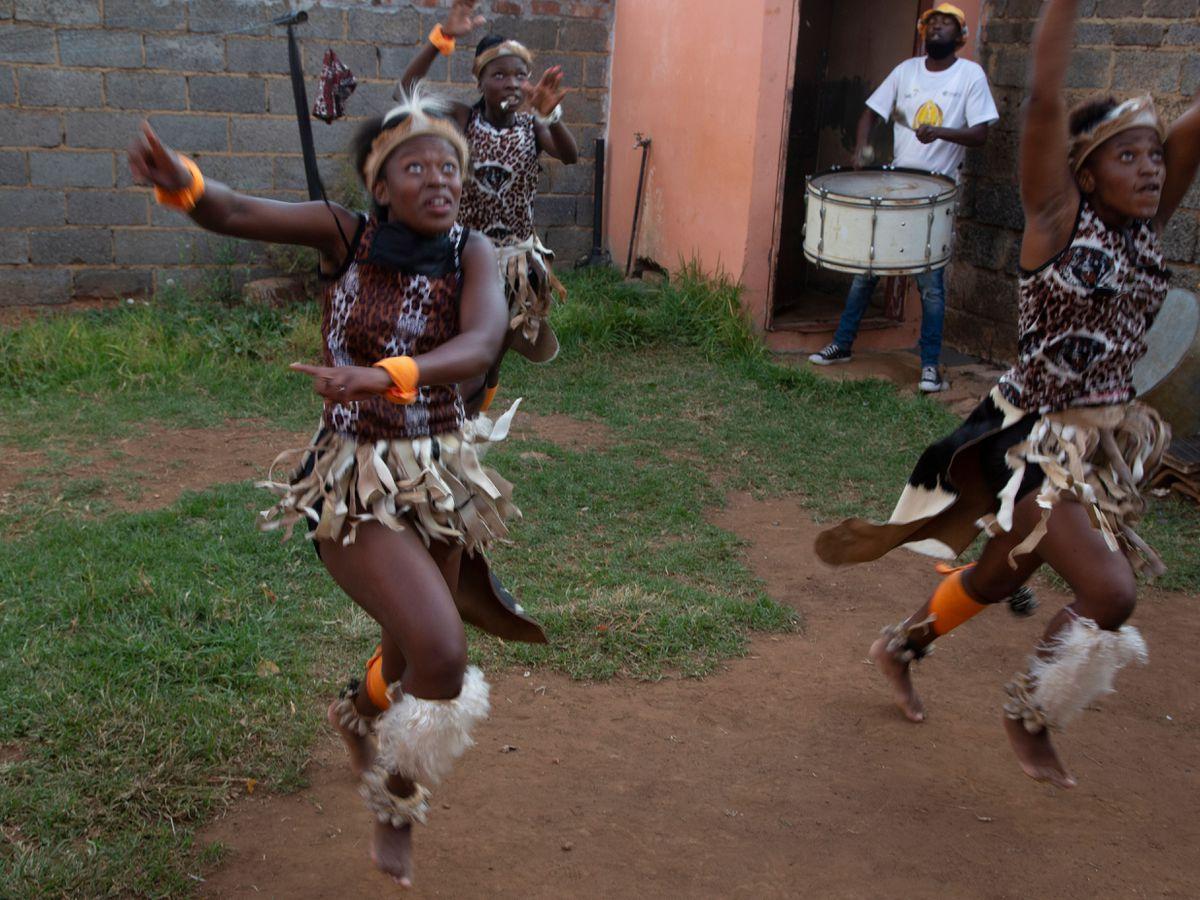 A group of girls perform a traditional Zulu dance (Denis Farrell/PA)