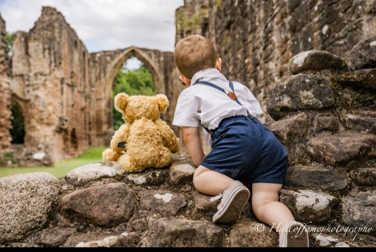 Elliot Short, two, from St. Georges with his Merrythought bear at Lilleshall Abbey