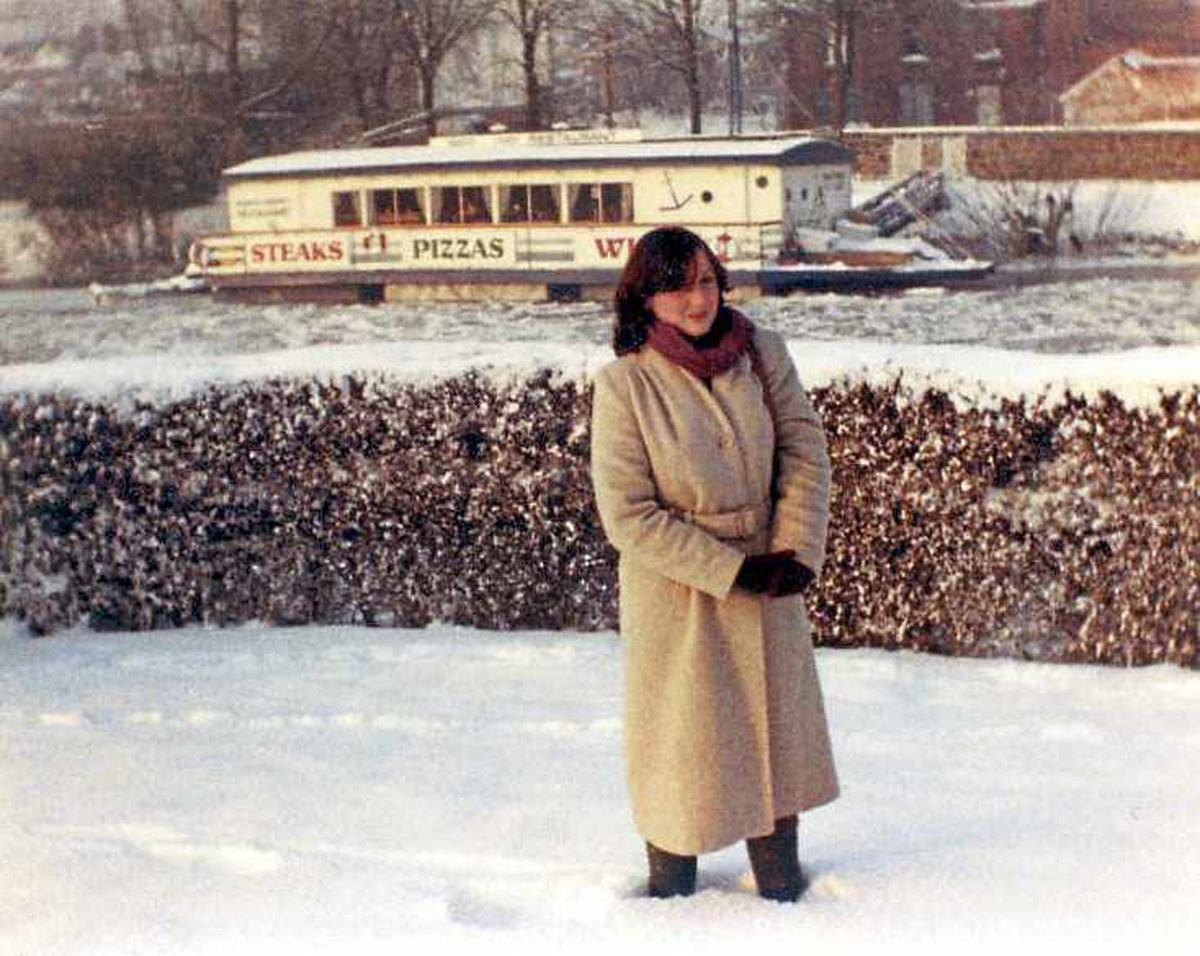 Shropshire Star reporter Sue Austin, then Moir, close to the frozen River Severn in Shrewsbury, with the floating restaurant behind