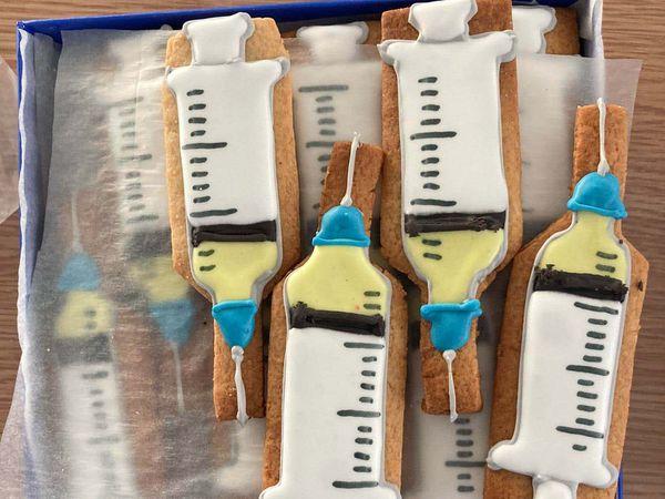 Coronavirus vaccine centre celebrates opening with handmade syringe biscuits