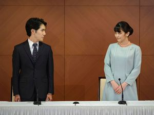 Japan's former Princess Mako, right, the elder daughter of Crown Prince Akishino and Crown Princess Kiko, and her husband Kei Komuro, look at each other during a press conference to announce their marriage at a hotel in Tokyo, Japan
