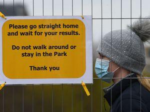 People take part in coronavirus surge testing on Clapham Common