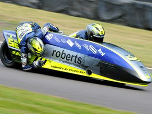 Passenger Tom Bryant claimed a podium in the opening sidecar race. Picture: Ian Ward