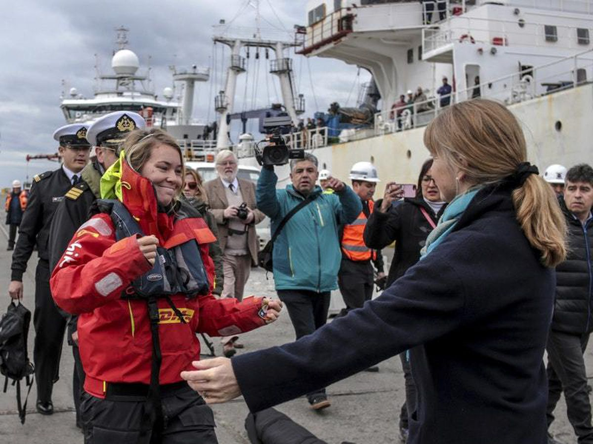 Susie Goodall walks into the waiting arms of her mother in Punta Arenas, Chile