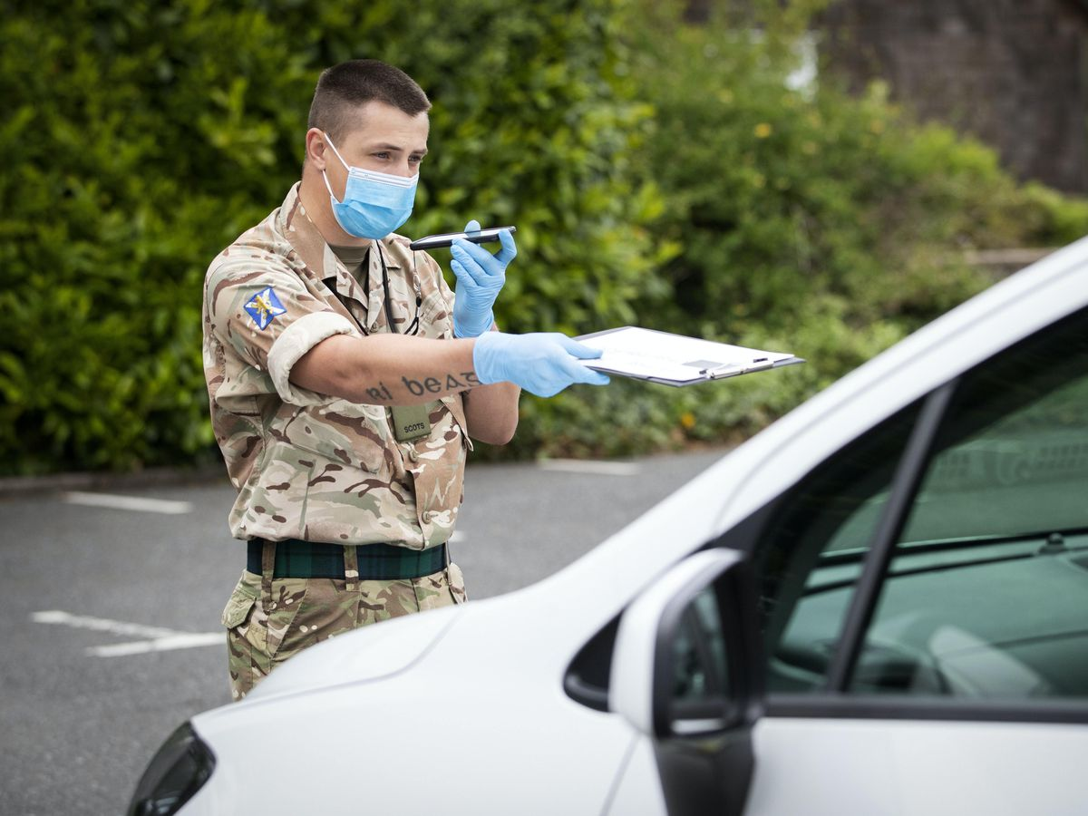A soldier working at a coronavirus testing unit