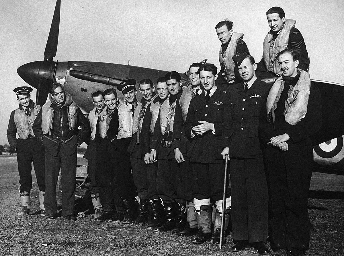 Seated left on the Hurricane wing, with colleagues.