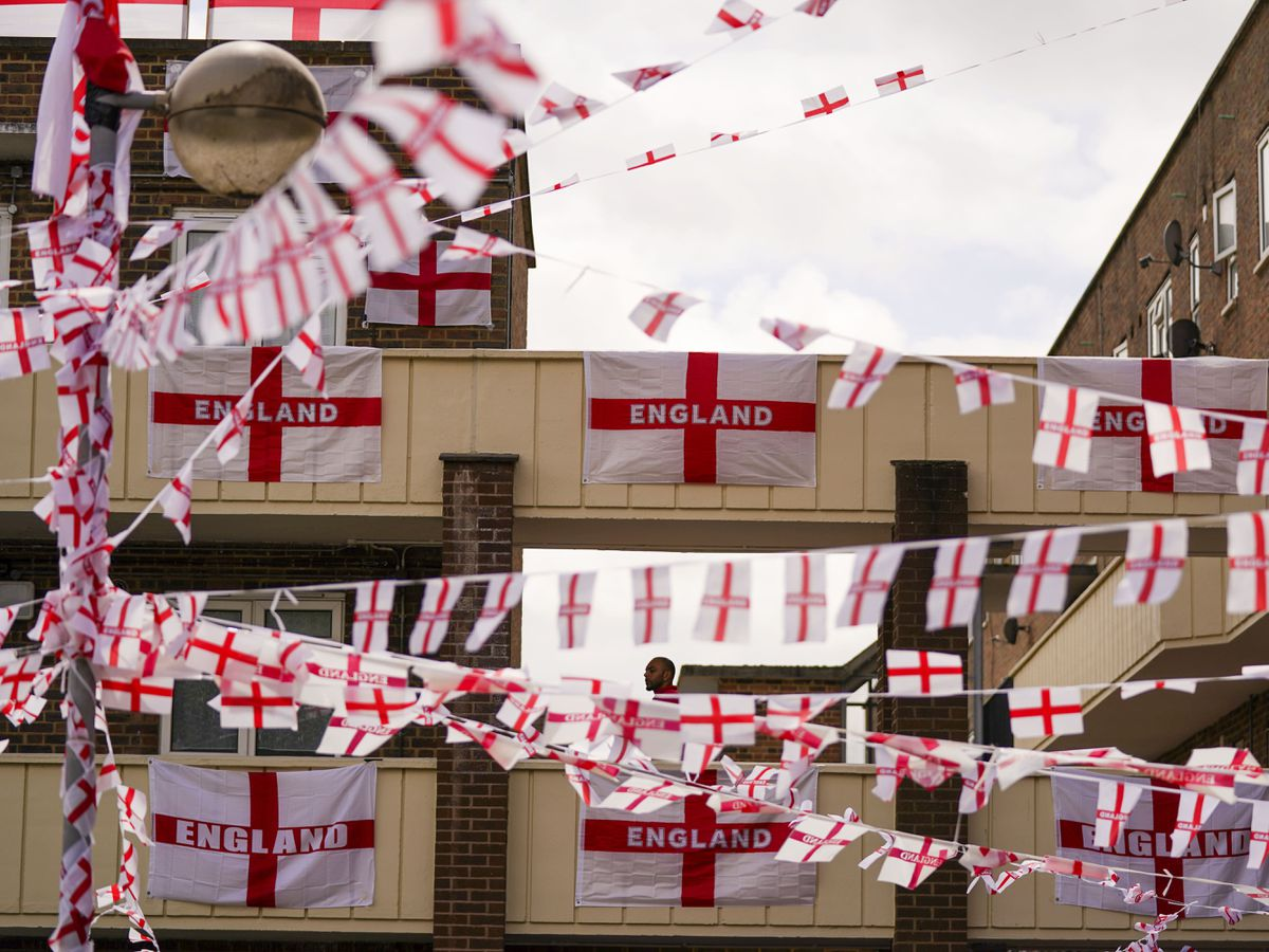 The residents of Towfield Court in Feltham have transformed their estate with England flags (Steve Parsons/PA)