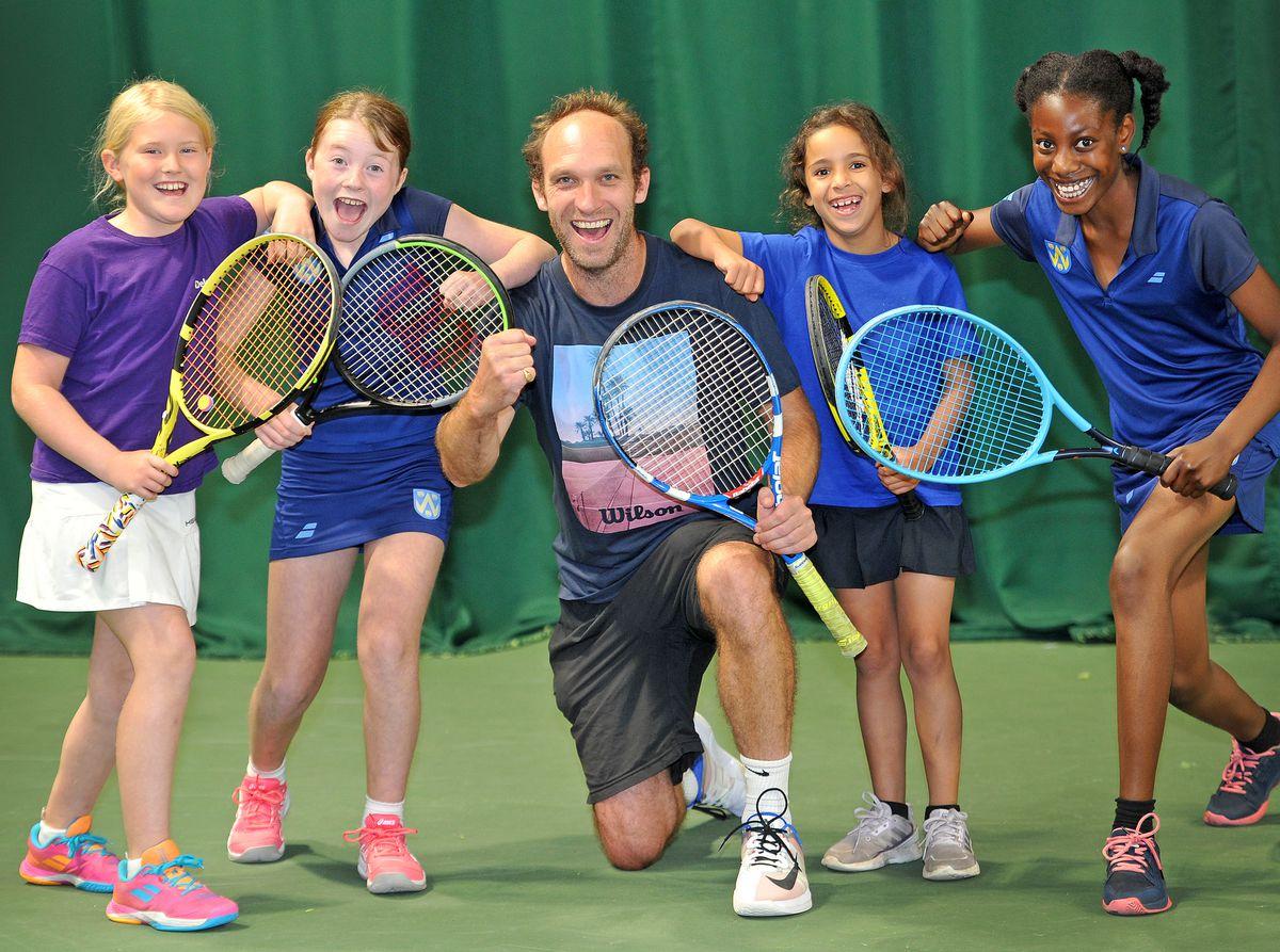 Tennis coach Adam Wharf with budding players Iris Burton, Maddie Crabb, Georgie Howson and Gwen Klu