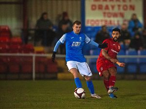 Market Drayton Town in action last January before the first national Covid lockdown. Drayton have not played since October 31.