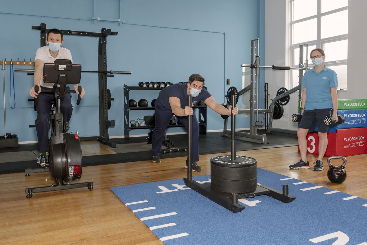 Members of the physiotherapy team - Rob Fox, Michael Murphy and Lisa Perry - with the new gym equipment