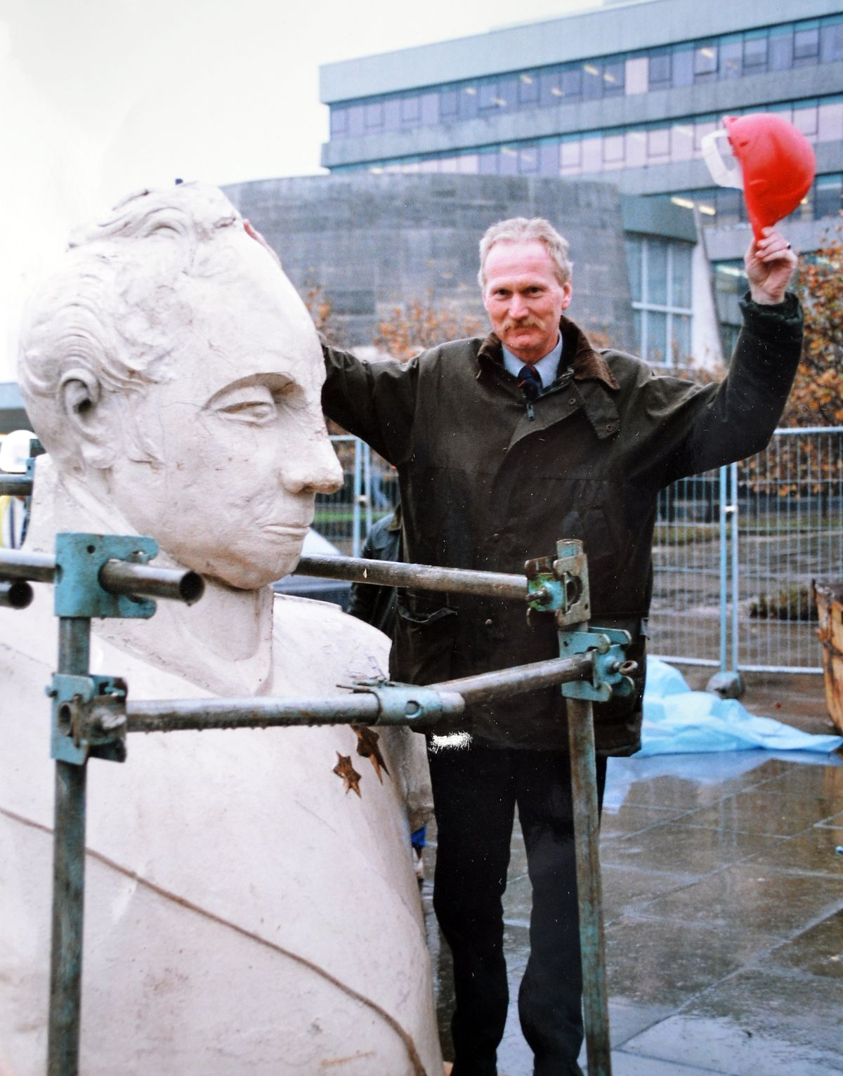 Man down... Roger Howells of Shropshire County Council with part of the statue safely on the ground.