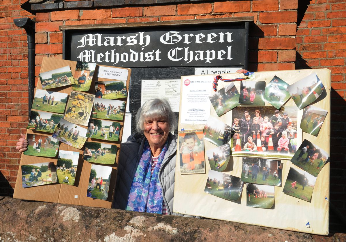 Chapel steward Alison Evans with display boards of Sunday School events