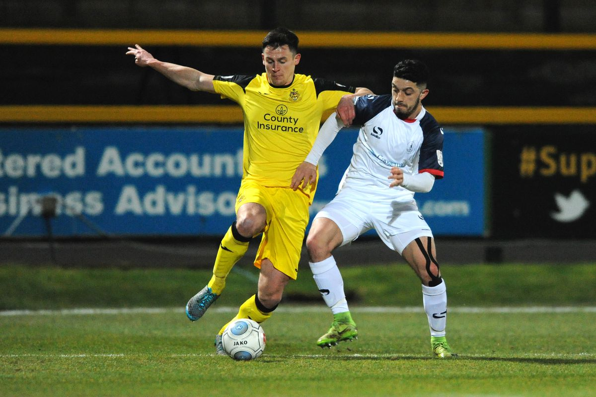 Jordan Murphy battles for the ball with Southport's Graham Kelly