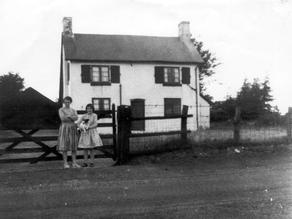 Pole Cottage and visitors in about 1960.