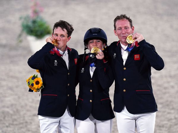 Great Britain's Laura Collett, Tom McEwen and Oliver Townend with their gold medals for the Eventing Jumping Team Final