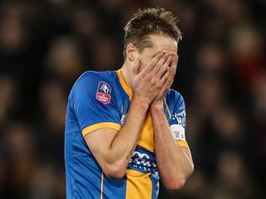 A dejected David Edwards of Shrewsbury Town reacts at full time.